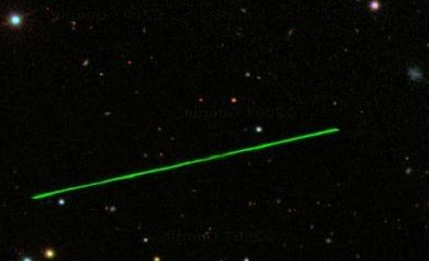 A Green Laser Beam in Space on Google Sky